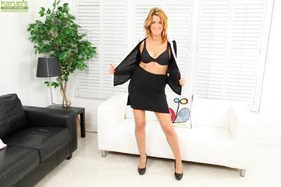 Milf beauty Jamie Johansson is undressing her tight black skirt