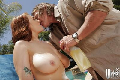 Milf redhead has her pornstar ass pounded hardcore at the poolside