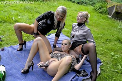 Lascivious blonde babes having lesbian fun and pissing outdoor