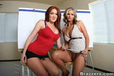 Two big titted lesbian MILFs helping each other to get undressed
