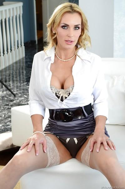 Seductive MILF Tanya Tate stripping off her suit and lingerie