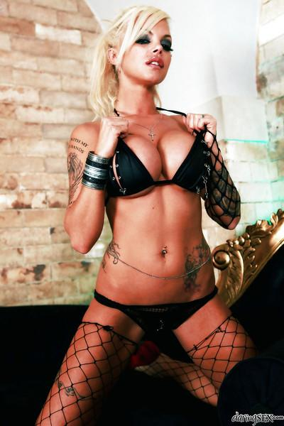 Tattooed blonde in stockings Delta White showcasing her voluptuous curves