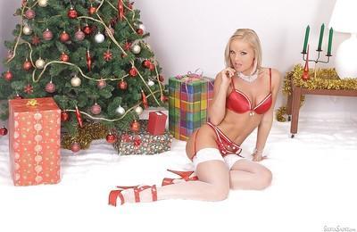 MILF pornstar Silvia Saint posing in hot red lingerie under X-mas tree