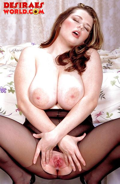 Chunky MILF pornstar in crotchless pantyhose spreading shaved pussy