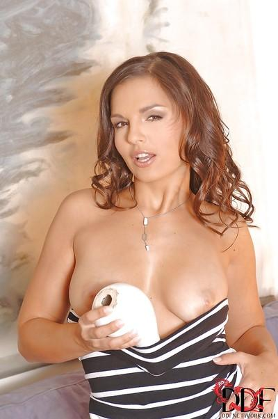 Luscious brunette pornstar revealing her tits and toying her juicy cunt