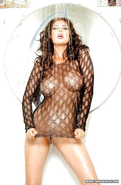 Curvaceous brunette MILF with slender legs gets drenched in the shower