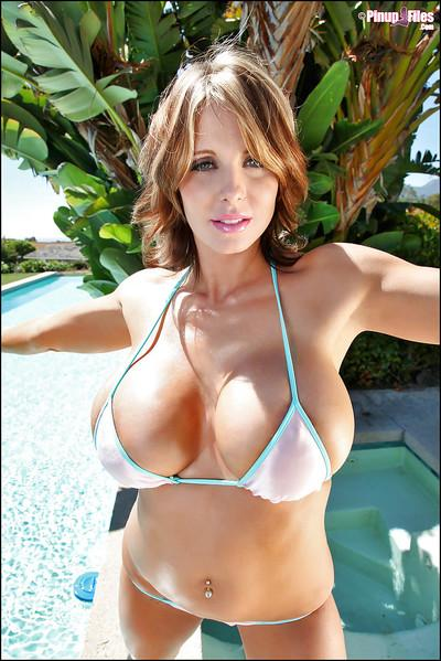 Busy MILF Brandy Robbins posing outdoors beside swimming pool in bikini