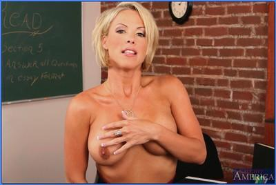 Gorgeous MILF teacher Kayla Synz strips from red lingerie and posing
