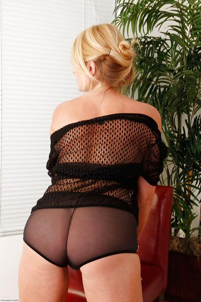 Well-stacked blonde MILF taking off her lingerie and teasing her bald slit