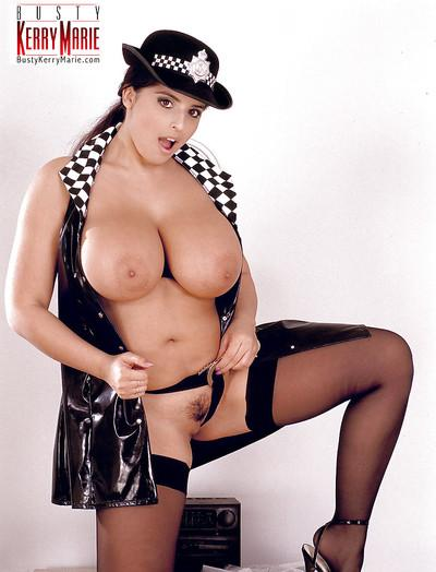 Plump MILF pornstar Kerry Marie flaunting big tits in police uniform