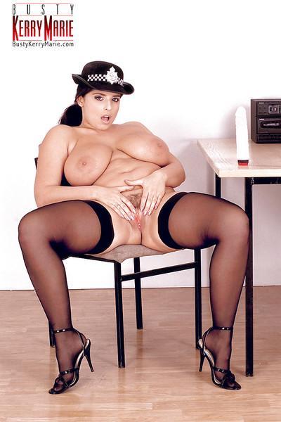 Plump MILF pornstar Kerry Marie flaunting big tits in police uniform