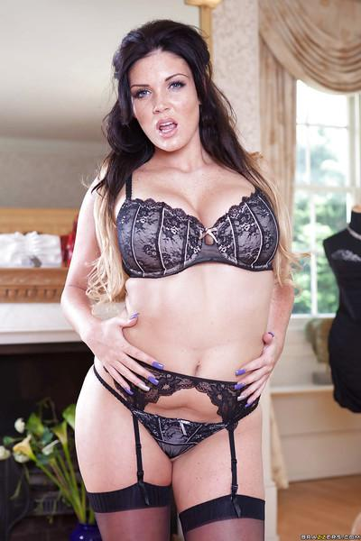 Slim milf in an outstanding black stockings Emma Leigh posing