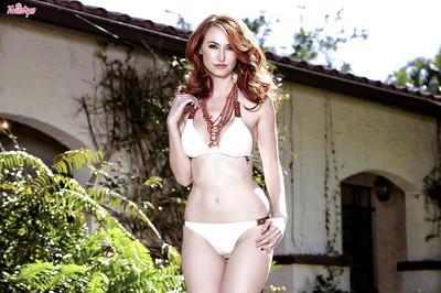 Pretty milf babe Kendra James is a gorgeous redhead pornstar