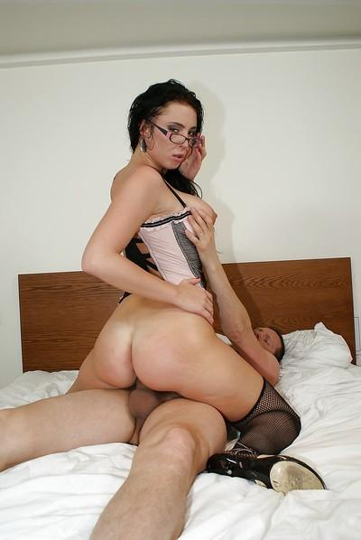 Busty vixen in glasses and stockings enjoys hard pussy pounding