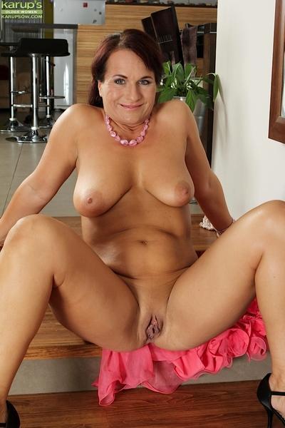 Hot tanned brunette Katherine Ross demonstrates her white panties