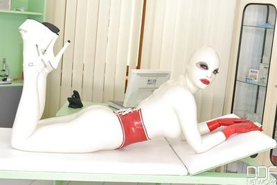 Latex wrapped fetish model from Europe Latex Lacy masturbating exposed twat