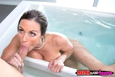 Awesome brunette cougar milf Giselle gives a wet bath blowjob