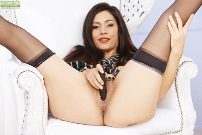 Busty MILF Raylene stripping off stockings and fondling big juggs
