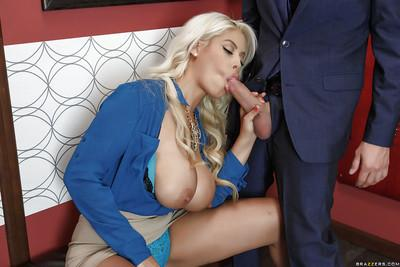 Chesty blonde MILF Bridgette B having massive melons suckled at work