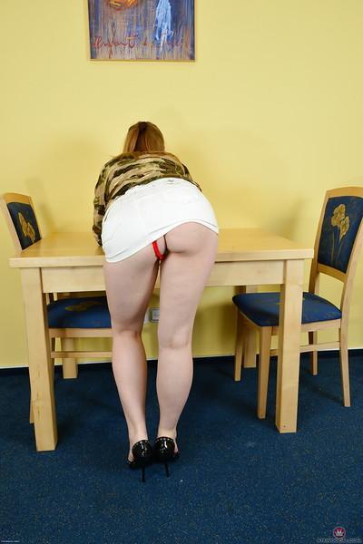 Redhead MILF Mischelle sliding red underwear aside to expose cunt and anus