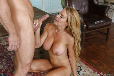 Busty blonde MILF Corrina Blake giving a blowjob and getting a facial
