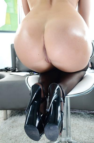 Chanel Preston uncovering her gorgeous curves and slipping on a strapon