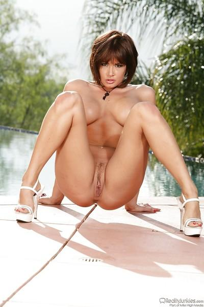 Seductive babe with long legs Tory Lane stripping by the pool