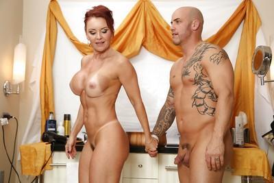 Naughty cougar Janet Mason giving handjob and blowjob to younger man