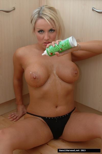 European milf Dannii Harwood is demonstrating her pornstar big tits