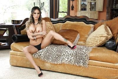 Tattooed Latina Nadia Styles strips naked to bare MILF pussy