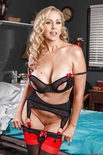 Seductive blonde MILF Julia Ann revealing her big boobs and petite ass
