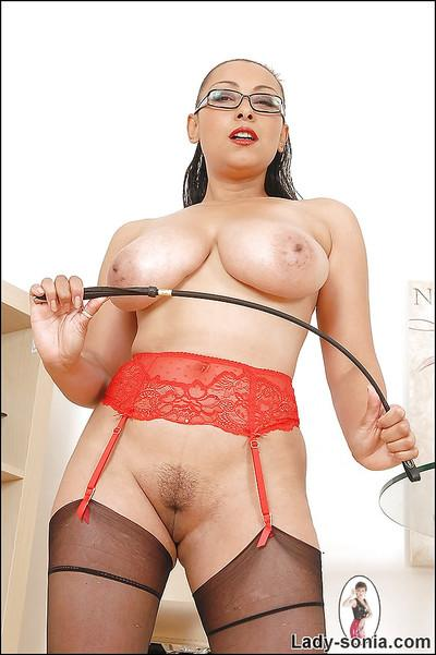 Topless fetish lady with massive jugs lowering her red panties