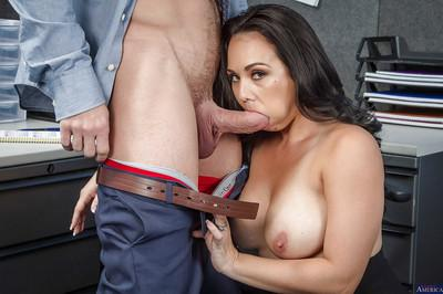 Tanned brunette Holly West is sucking a hardcore pole at her work