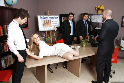Busty MILF babe Julia Ann has hardcore sex right in the office