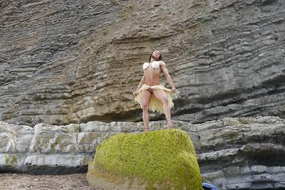 Bodybuilder babe Karyn showing off big tits and muscular body on beach
