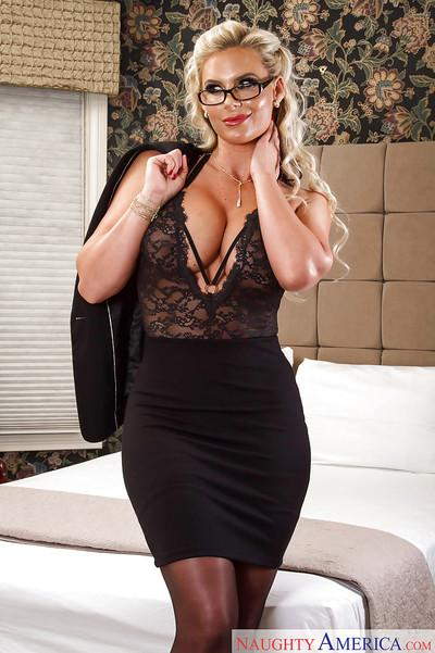 Blonde mom Phoenix Marie posing fully clothed in black outfit and heels