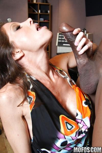 Busty horny MILF Angel likes to suck and fuck a big black cock