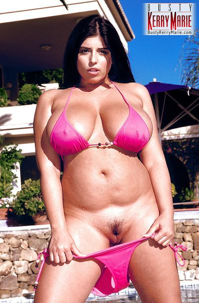 Chubby Euro MILF Kerry Marie frees large pornstar tits from bikini in pool