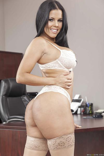 Busty brunette Diamond Kitty demonstrates her awesome body at her work