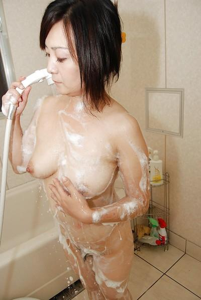 Sassy japanese MILF taking shower and rubbing her soapy bush