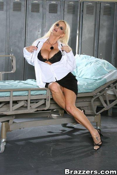 Luscious MILF in doctor uniform Rhyse Richards shows off her goodies