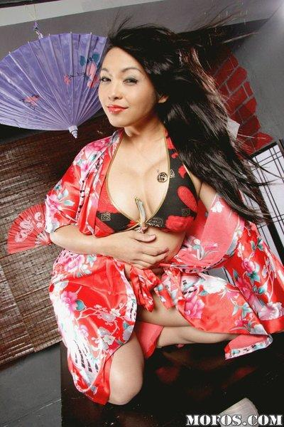 Sassy asian MILF Mika Tan uncovering her fuckable curves
