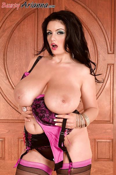 Top heavy European brunette Arianna Sinn struts in lingerie and stockings