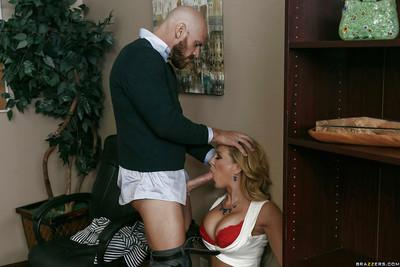 Blonde secretary Cherie Deville spreads hose covered legs for cunt licking