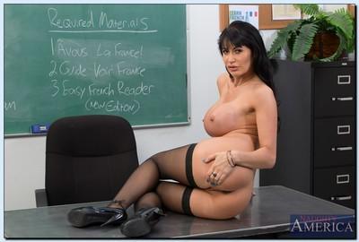 Sexy teacher in glasses Eva Karera getting naked in the classroom