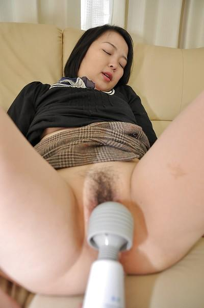 Asian MILF Asami Sawai takes off her panties and enjoys sex toys play