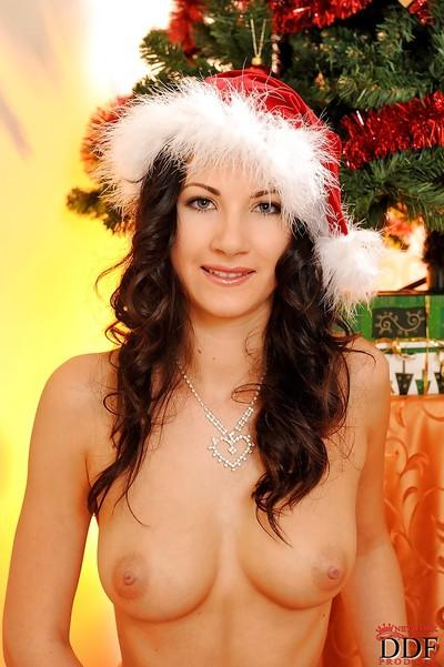 Stunning MILF with amazing tits stripping off her Christmas outfit