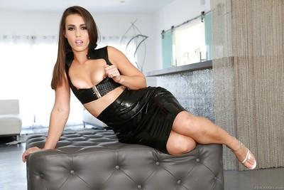 Bare assed MILF babe Roxy Raye posing in high heels and skirt
