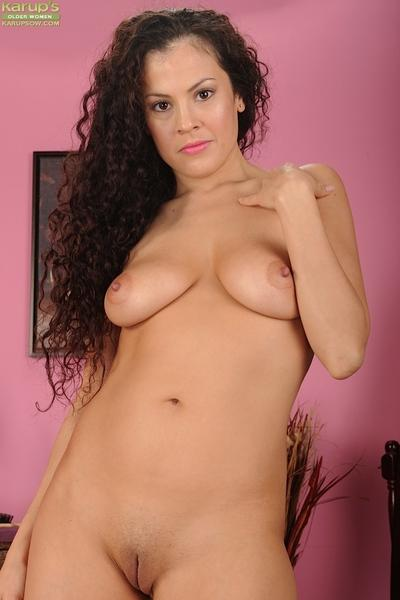 Milf babe Alejandra undressing in her room to show her big boobies