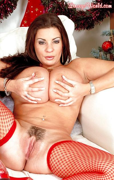 Brunette European mom Linsey Dawn McKenzie unveiling big juggs at Christmas